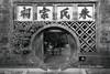 The-round-door,-Zhu-Family-Garden,-Jianshui-Ancient-Town,-Yunnan-Province,-China