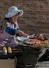 Woman-cooking-street-food,-Shengcun-Market,-Yuanyang,-Yunnan-Province,-China