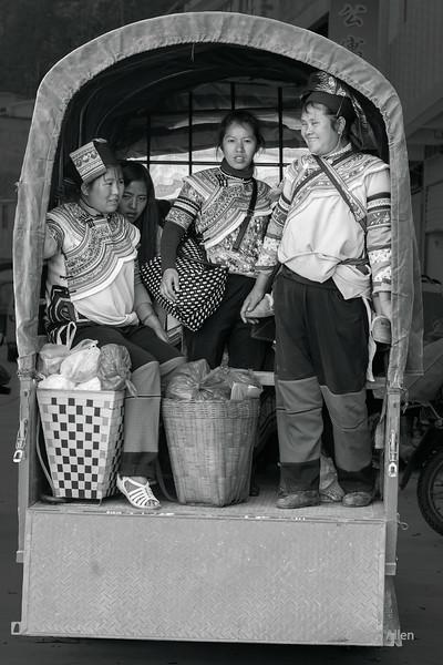 Full-truck-on-market-day,-Niujiaozhai-Town,-Yunnan-Province,-China