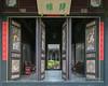 Carved-doors-and-view-through-to-courtyard,-Zhu-Family-Gargen,-Jianshui-Ancient-Town,-Yunnan-Province,-China