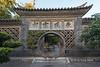 Round-door-into-the-inner-courtyard,-Zhu-Family-Garden,-Jianshui-Ancient-Town,-Yunnan-Province,-China