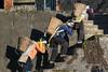 Three-women-hauling-gravel-up-some-stairs,-Malizai-area,-Yunnan-Province,-China