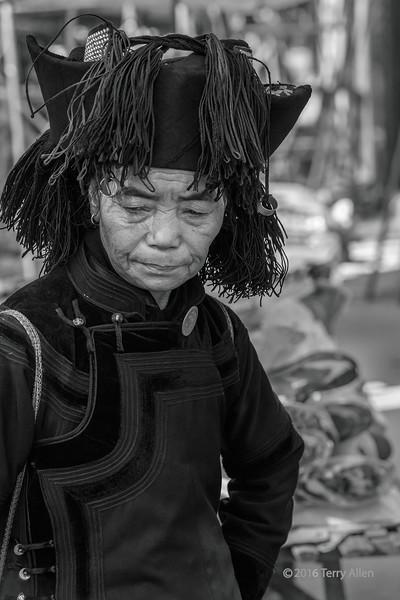 Portrait-of-a-Yunnan-Miao-matron,-Shengcun-Market,-Yuanyang,-Yunnan-Province,-China