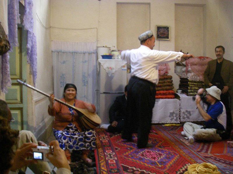 In this home, we had a special treat - the husband and wife serenaded us with a traditional song and dance.