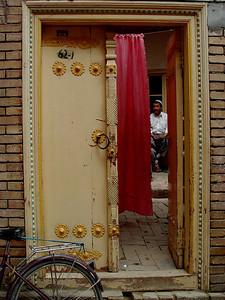 Kashgar courtyard entry with man DSC01667