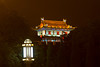 Pagoda architecture in the buildings along the city wall in Xian, China illuminated at night.