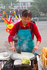Preparing street food in Xing Qing Park in Xian, China, Asia.