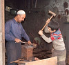 Metal workers, Kashgar, China.