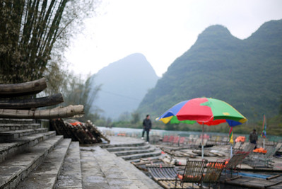 Rafts are ready and banked in off-season in the hopes of wandering tourists outside of Yangshuo, China.