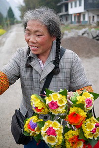 Pretty flowers are pedaled by the locals near Yangshuo, China.