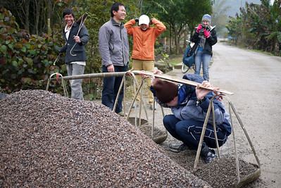 Pete shouldering the load of gravel in Yangshuo, China.