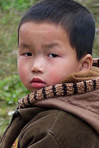An adorable little boy out exploring the rice paddies on his own outside of Yangshuo, China.