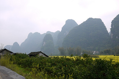 Wooden houses in the rural regions mark the houses of farmers outside of Yangshuo, China.