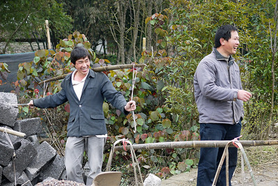 The workers watch as my friend Pete attempts to carry their load into the rice paddies around Yangshuo, China.
