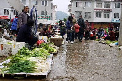 The wet streets and cool weather don't deter the vegetable vendors at the Fuli Market near Yangshuo, China.