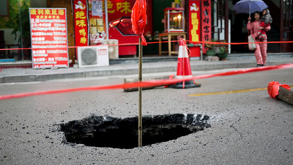 Poor road construction in a sudden sink hole in Yangshuo, China.