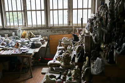 A collection of antiques and a jumble of junk in Yangshuo, China.
