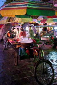 Street carts selling steaming foods in Yangshuo, China.