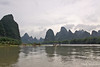 Floating on the Li River with Karst reflections