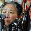 "Chinese lady selling trinkets along a tourist strip - Yangshuo, China.  This is a travel photo from Yangshuo, China. <a href=""http://nomadicsamuel.com"">http://nomadicsamuel.com</a>"