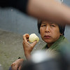 "Today's daily travel photo is of a Chinese lady eating an apple in a hectic street area of Yangshuo, China framed by a motion blurred bicycle:<br /> <a href=""http://nomadicsamuel.com/photo-blog/lady-eating-apple-yangshuo-china"">http://nomadicsamuel.com/photo-blog/lady-eating-apple-yangshuo-china</a>"