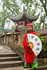 A dynasty warrior in ethnic dress welcomes guests to the city of Ghosts in Fengu, China, Asia.