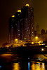 The tall buildings of downtown illuminated at night in Chongqing, China, Asia.