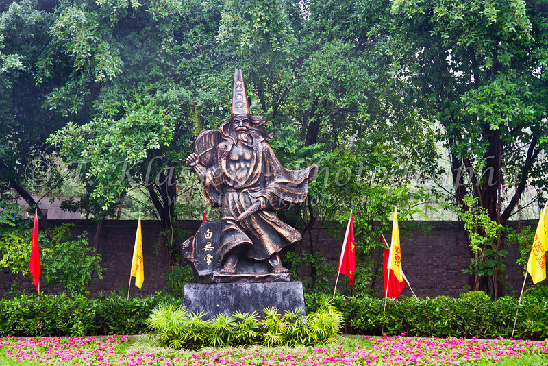 Dynasty warrior statue in the City of Ghosts in Fengdu, China, Asia.