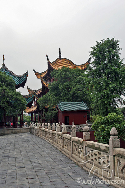 Walkway to Pagodas over decorative bridge