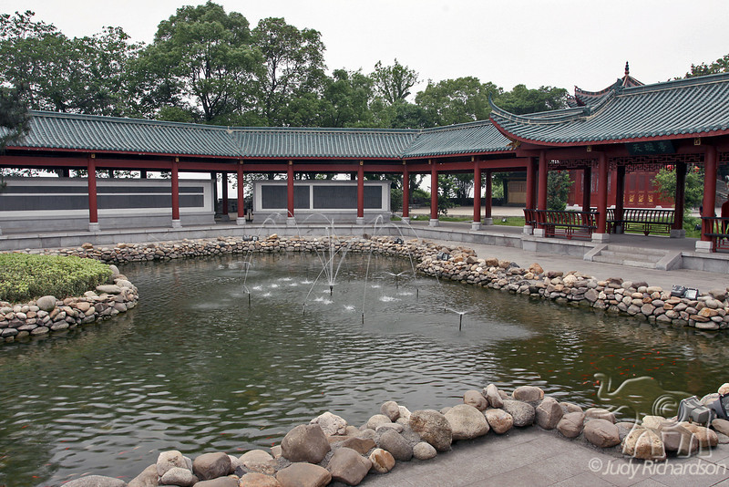 Pond with fountains and walkway
