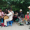 Chinese seniors love to go to the park on weekends to sing and play music