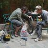 Yann getting bike repair help from the hostel staff