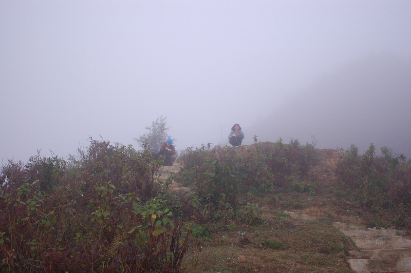 Emilie and a local who sells boilled egg to photographers in the morning.  The fog is still to dense too see the terraces.