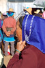 Bai woman tries new blue headscarf