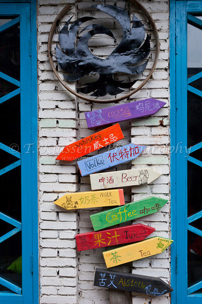 Direction signs in the window of an outdoor market in the water village of Zhujiajiao, near Shanghai, China, Asia.