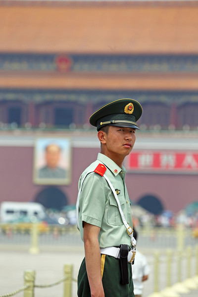 Being watched by Mao and others in Tiananmen Square, Běijīng, China