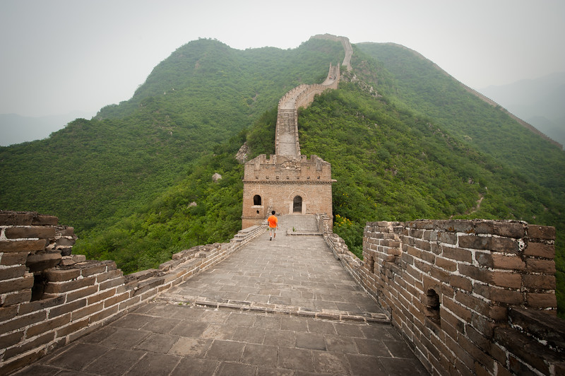 A man walks along a steep section of the Great Wall of China, Beijing, China