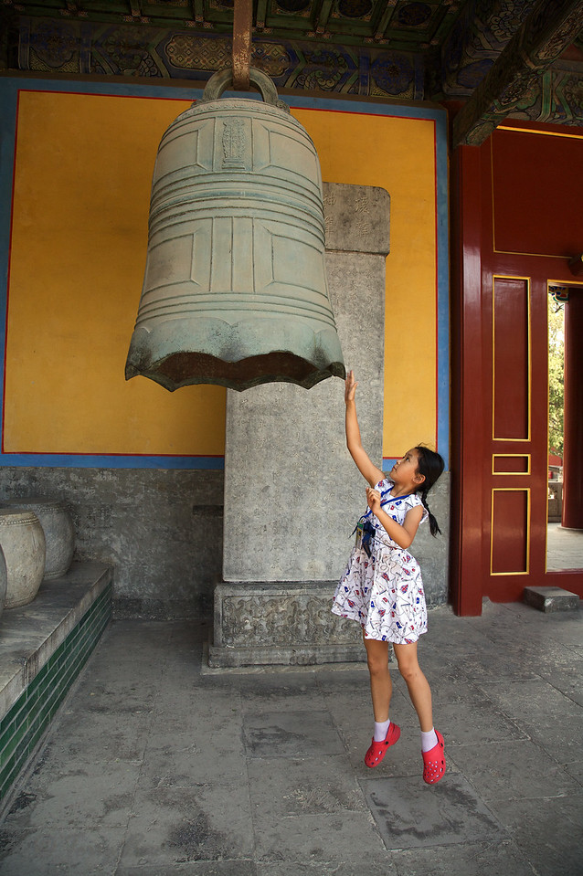 Striking the Bell at the Temple of Confucius in Beijing
