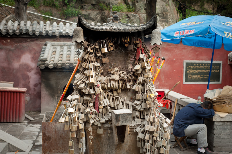 An ancient monument covered in love locks, Taishan, China