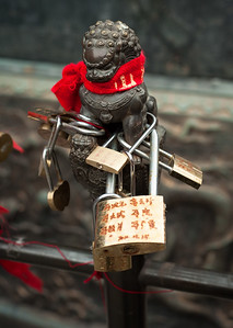 Small carved dragon with padlocks attached, Taishan, China
