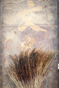 A traditional sweeping brush leaning up against a wall, Pingyao, China