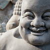 Smiling stone buddha statue