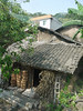 The relocated farmer was given the house at rear, adjoining the house in front, which belongs to neighbors who were there before his house was built. He got such a big house because there were 17 family members, and some members added some money to build a still larger house.<br /> <br /> His farm was across the Yangtze River, below the current waterline.  The 300-mile-long reservoir, created by the Three Rivers Gorges Dam project, will be full by the end of this month, October 2009.  He is one of several million people relocated as a result of the project.  He has not seen the dam since 1988, when it was not yet complete.