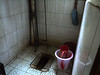 Probably a fairly typical rural bathroom, complete with water for washing with (no TP) and for flushing the toilet.