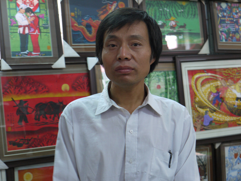 This man, Wang Nai Liang, painted all the paintings in this gallery.   Wonderful paintings of farm life.  He is among a celebrated collection of farmer painters in Huxian, with painting sold around the world.