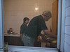 Inside the kitchen, beyond the breezeway, are a number of hot propane burners.  Peter is working as fast as he can with a wok to keep from burning the stir-fry.