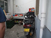 Mr. Wong drives this motorcycle to his factory, with 12 year old son on the back.  This is the breezeway near the kitchen.