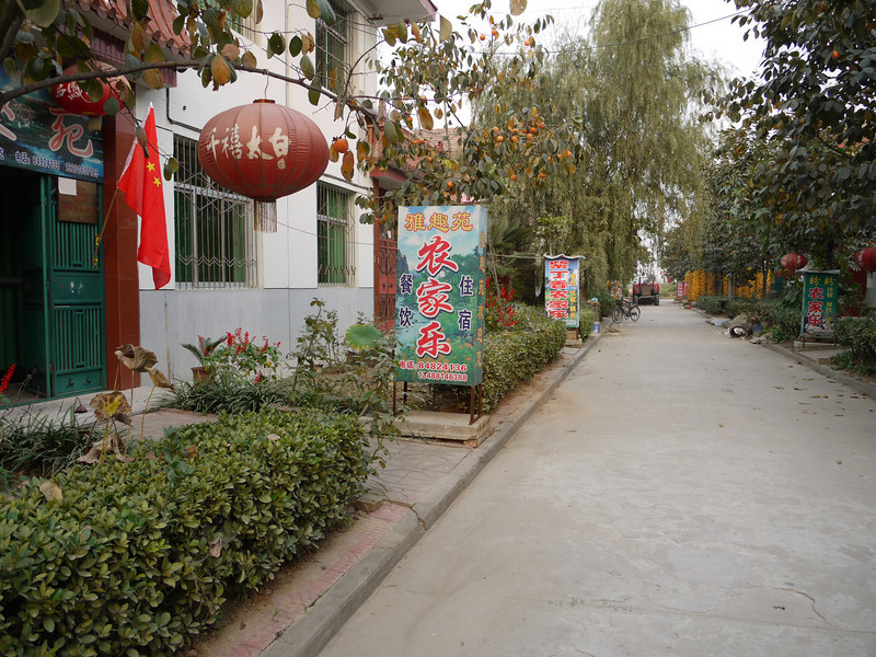 A street in the new village.  Our homestay was in this house, designated as a sort of B&B, probably used most by Overseas Adventure Travel.