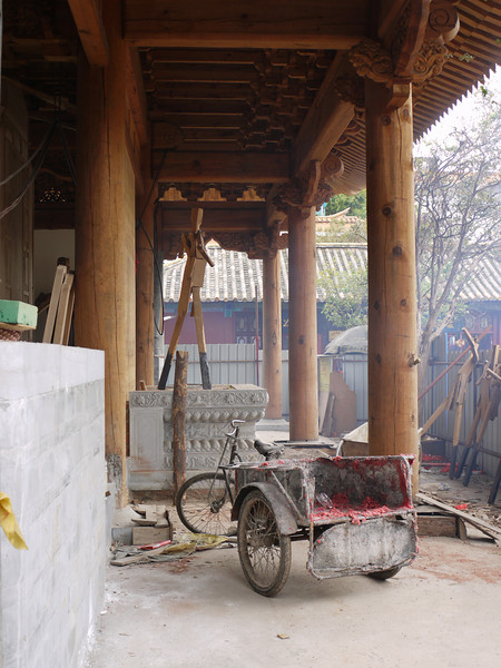 This temple is under reconstruction.  Here it waits for the colorful paint under its eaves.