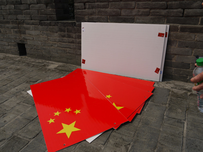 5 x 8 foot PRC Flag placards, ready to be hung over the top of the Xian city wall -- on the day before National  Day.